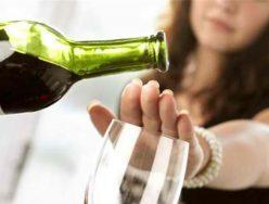 How can I stress the importance of not drinking alcohol to clients who want to lose weight?