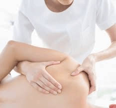 Manual therapy by physical therapist on shoulder